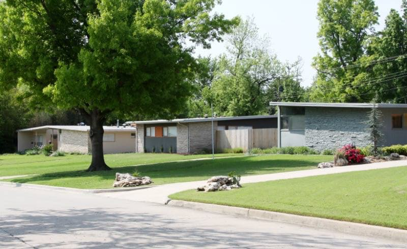 Three similar single-family mid century modern style rancher homes.