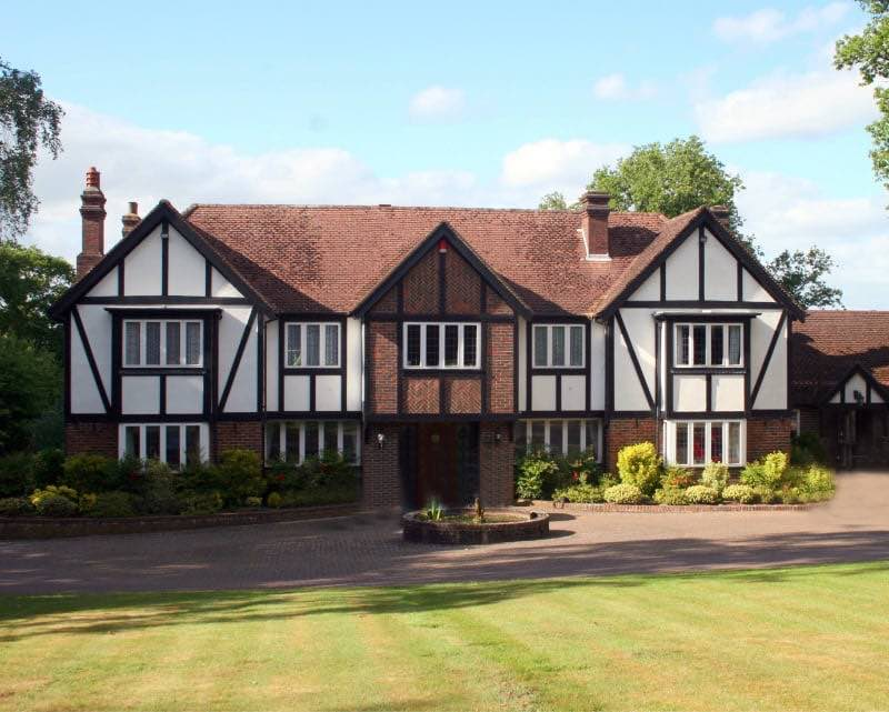 Single-family Tudor style home.