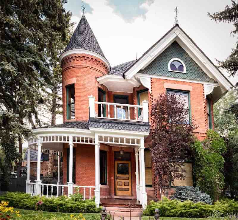 Victorian style home with curved front porch.